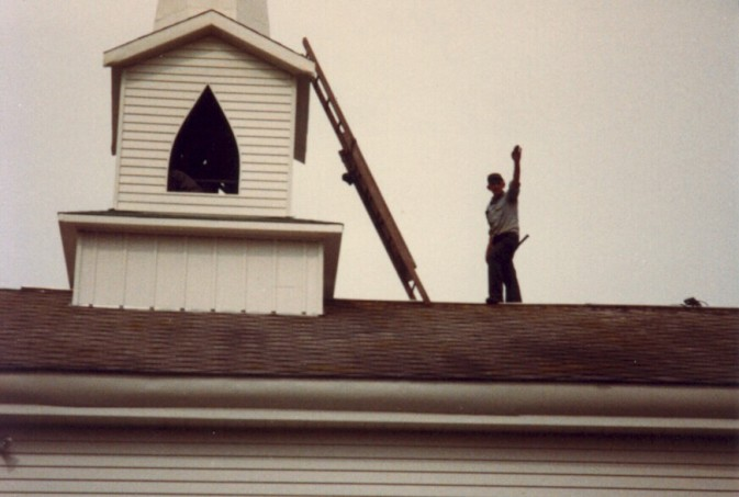 Helping to build the church steeple in 1983